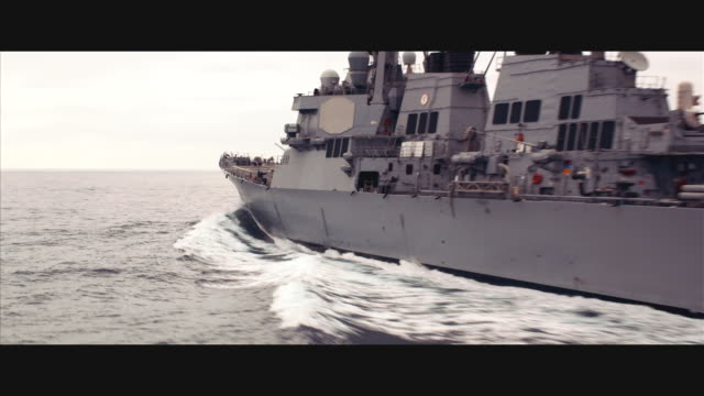 aerial circling guided missile destroyer uss john paul jones ddg-53 at sea - warship stock videos & royalty-free footage