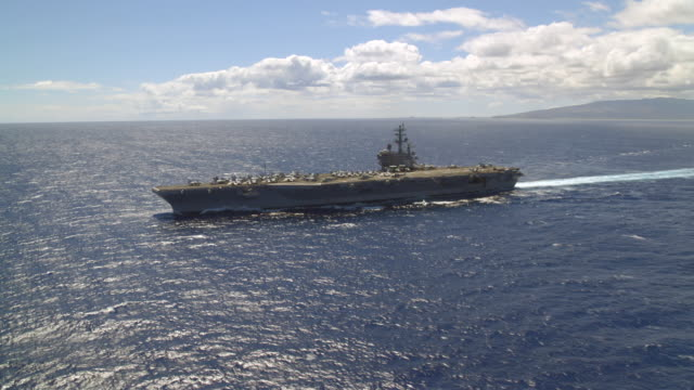 aerial of aircraft carrier ronald reagan cvn-76 at sea - fighter stock videos & royalty-free footage