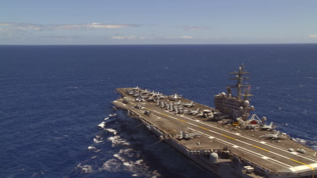 aerial of aircraft carrier ronald reagan cvn-76 at sea; close on bow - us navy stock videos & royalty-free footage