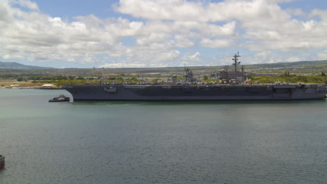 aerial of aircraft carrier ronald reagan cvn-76 leaving pearl harbor - aircraft carrier stock videos & royalty-free footage