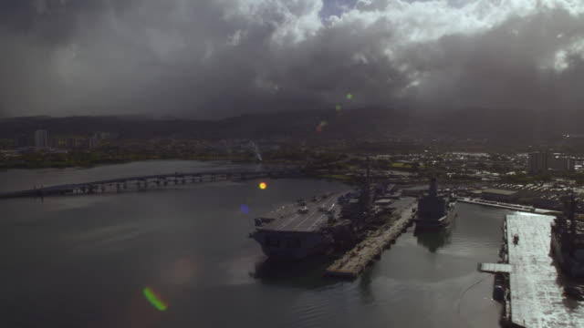 aerial aircraft carrier uss ronald reagan cvn-76 docked at pearl harbor - aircraft carrier stock videos & royalty-free footage