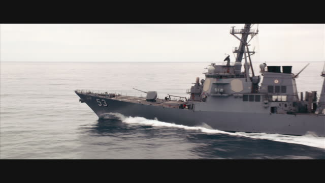 aerial tracking guided missile destroyer uss john paul jones ddg-53 at sea - warship stock videos & royalty-free footage