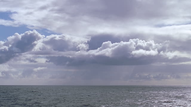 clouds over ocean (god shot) - seascape stock videos & royalty-free footage