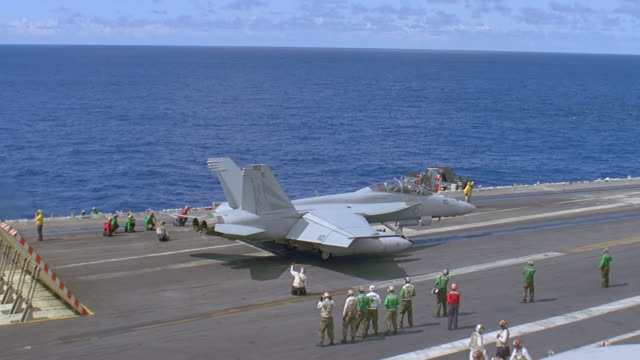 navy jet t/o on deck of aircraft carrier - aircraft carrier stock videos & royalty-free footage