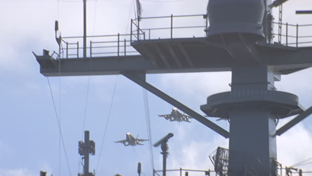 2 - jets fly over aircraft carrier - royal navy stock videos & royalty-free footage