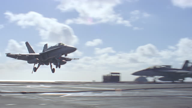 jet lands on aircraft carrier - fighter stock videos & royalty-free footage