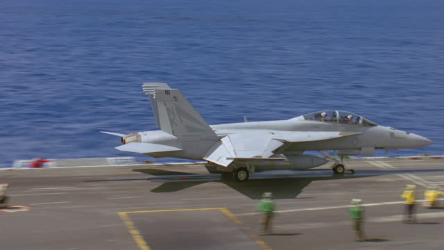 navy jet t/o from aircraft carrier - aircraft carrier stock videos & royalty-free footage