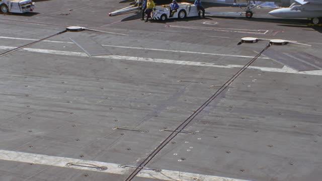 navy jet lands on aircraft carrier - スウィッシュパン点の映像素材/bロール