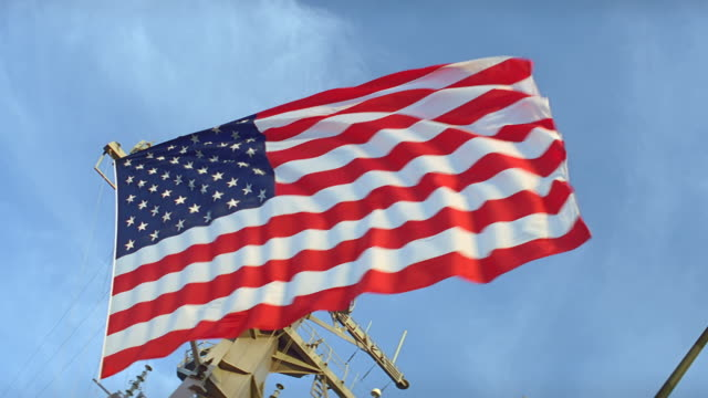 ua u.s. flag flies from deck of navy ship - navy stock videos & royalty-free footage