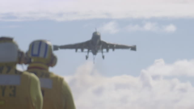 navy jet lands on aircraft carrier - aircraft carrier stock videos & royalty-free footage