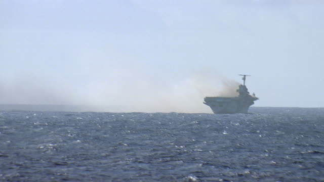 aircraft carrier at sea emitting large amount of smoke - aircraft carrier stock videos & royalty-free footage