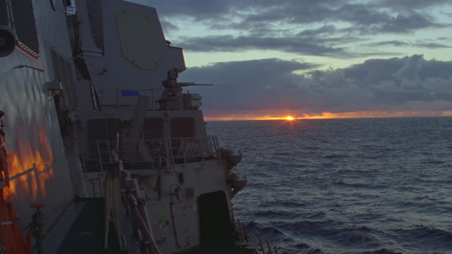 pov from deck of navy ship to ocean sunrise/sunset - us military stock videos & royalty-free footage
