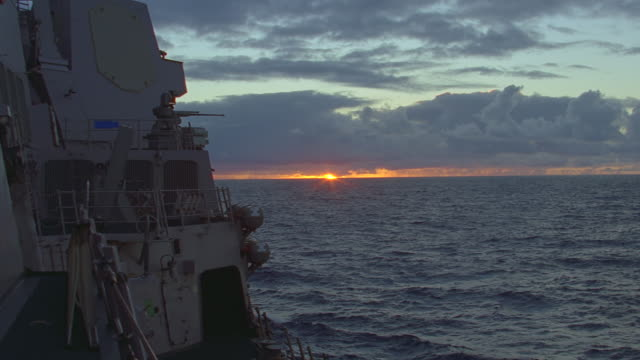 pov from deck of navy ship to ocean sunrise/sunset - battleship stock videos & royalty-free footage