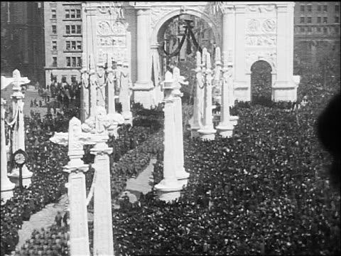 B/W 1918 high angle tilt down parade under temporary Victory Arch on Fifth Avenue at end of World War I / NYC
