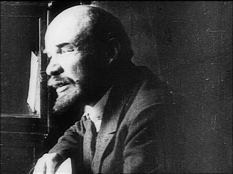 1910s close up profile v.i. lenin talking / documentary - reportage stock-videos und b-roll-filmmaterial