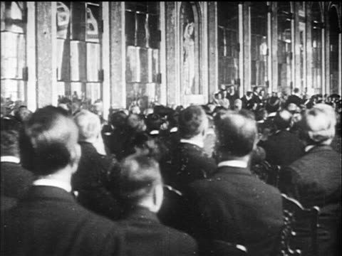 view crowd of men in great hall of mirrors / versailles peace conference france /doc - 1910 1919 stock videos and b-roll footage