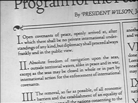 b/w 1919 close up president wilson's fourteen points document / documentary - 1919 stock-videos und b-roll-filmmaterial