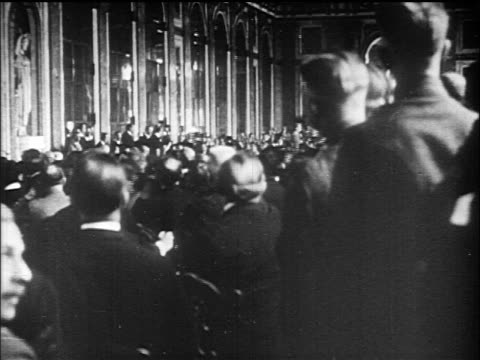 view crowd of men in great hall of mirrors / versailles peace conference france /doc - 1919 stock-videos und b-roll-filmmaterial