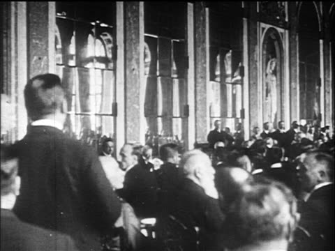 b/w 1919 delegates seated in great hall of mirrors / versailles peace conference france / doc - 1919 stock-videos und b-roll-filmmaterial