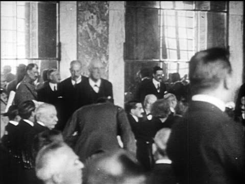 b/w 1919 delegates walking in great hall of mirrors / versailles peace conference france / doc - 1919 stock-videos und b-roll-filmmaterial