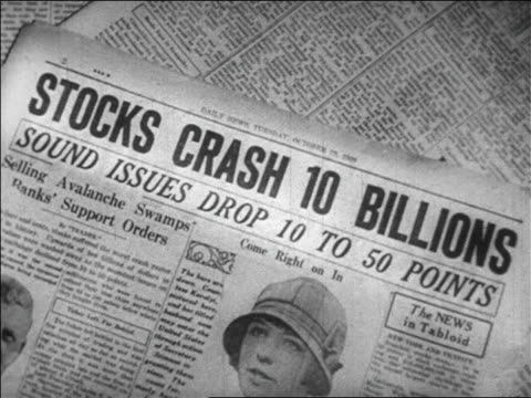 B/W 1929 close up newspaper headline announcing Stocks Crash 10 Billions / newsreel
