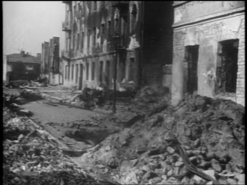 b/w 1939 shelled buildings on city street after german bombings / warsaw poland / documentary - warsaw stock videos & royalty-free footage