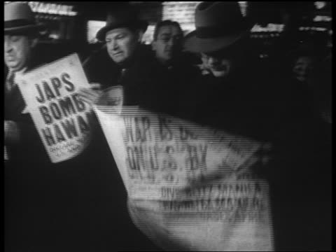 "dec. 7 1941 men reading newspapers ""war is declared on u.s. by japs"" / newsreel - world war ii stock videos & royalty-free footage"