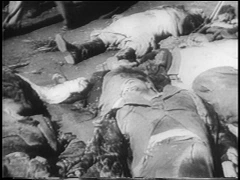 PAN dead bodies of Mussolini henchmen lying on ground / Milan / newsreel