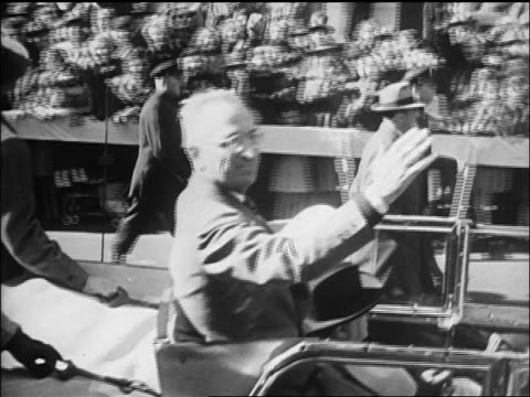 Harry Truman waving from car in Navy Day Parade in NYC / newsreel