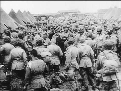 b/w june 5 1944 high angle eisenhower walking amongst paratroopers on eve of dday / europe - dwight eisenhower video stock e b–roll