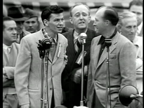 bing crosby + frank sinatra sing at war bond rally / bob hope + kay kyser heckle in background - frank sinatra stock videos & royalty-free footage