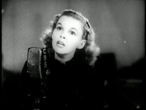 b/w 1944 close up judy garland singing over the rainbow into cbs radio microphone / newsreel - studio workplace stock videos & royalty-free footage