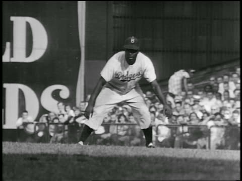 B/W 1940s PAN Jackie Robinson in Dodgers uniform stealing base during baseball game / documentary