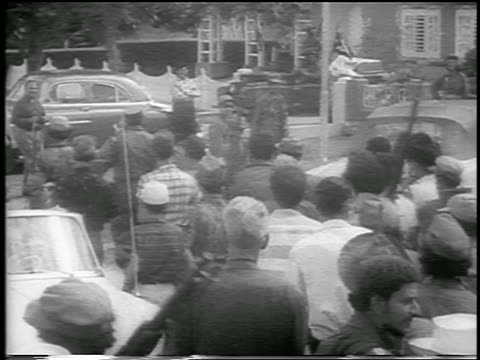 fidel castro followed by crowd walking on street / postrevolution havana / news - 1959 stock videos and b-roll footage