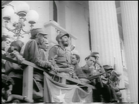 B/W 1959 low angle Fidel Castro making speech from balcony / postrevolution Havana / newsreel