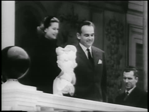 prince rainier + princess grace holding baby princess caroline posing outdoors - 1957 stock-videos und b-roll-filmmaterial