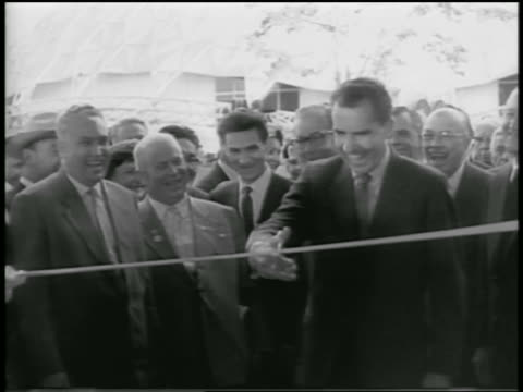 nixon cutting ribbon as khrushchev laughs claps shakes his hand / moscow - 1959 stock videos & royalty-free footage