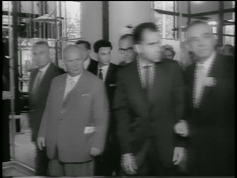 b/w 1959 tracking shot richard nixon nikita khrushchev walking in building of american expo / moscow - 1959 stock-videos und b-roll-filmmaterial