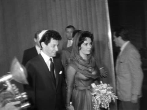 elizabeth taylor + eddie fisher in yarmulke walking from civil ceremony / newsreel - 1959 stock videos & royalty-free footage