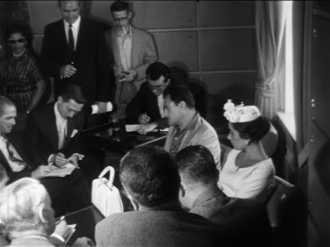 liz taylor + michael todd sitting + talking with reporters at press conference / newsreel - 1957 stock videos & royalty-free footage