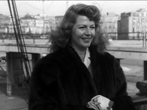 B/W 1951 close up Rita Hayworth smiling posing for media / Naples Italy / newsreel