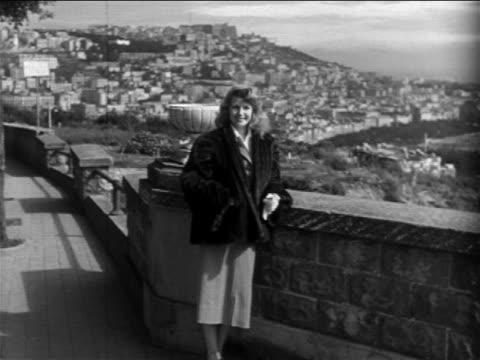 vídeos de stock e filmes b-roll de rita hayworth looking out over scenic view / naples, italy / newsreel - 1951