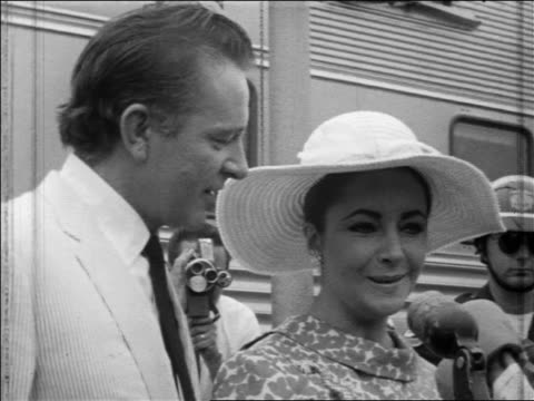 close up richard burton + elizabeth taylor talking into microphones at outdoor press conference - 1964 stock videos & royalty-free footage