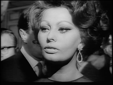 B/W 1965 close up Sophia Loren talking at press conference / London / newsreel
