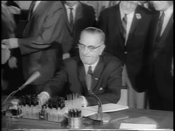 president lyndon johnson at desk signing civil rights act / others behind him / newsreel - 1964 stock videos & royalty-free footage