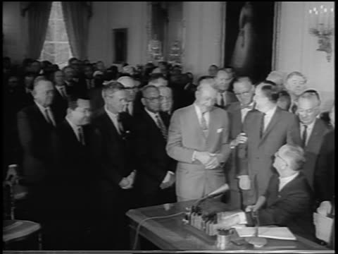 vidéos et rushes de president johnson giving pens to humphrey dirksen after signing civil rights act - 1964