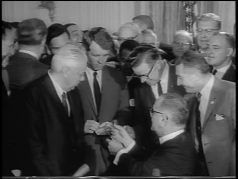 president johnson giving pens to robert kennedy at signing of civil rights act - generalstaatsanwalt stock-videos und b-roll-filmmaterial