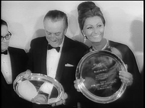 walt disney + sophia loren holding silver plate national theater owners awards / newsreel - sophia loren stock videos & royalty-free footage