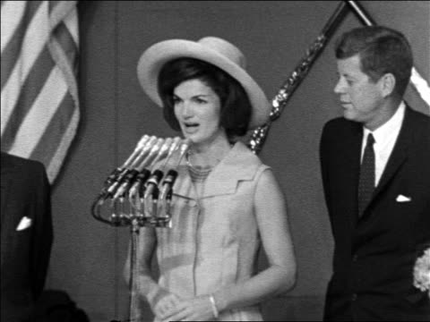 john kennedy watching as jacqueline makes speech in spanish / mexican president claps - cappello video stock e b–roll