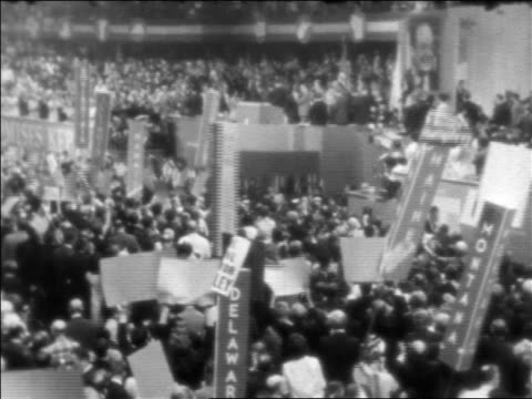 b/w 1968 high angle wide shot crowd holding signs at democratic national convention / chicago - 1968 stock videos & royalty-free footage